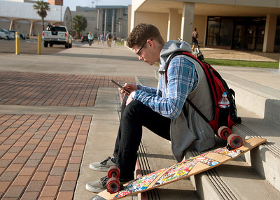 Relaxing student Preston Bowers embraces the sun on the stairs of Bay Hall