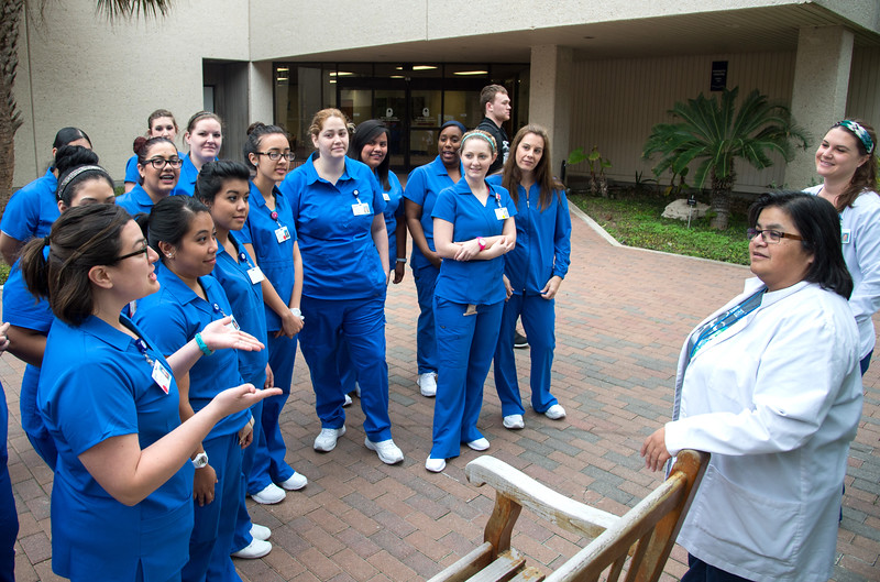 """Nursing students do the """"Clinical on Campus"""" lab in CI court yard."""