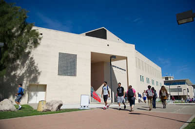 Students walk past the center for instruction on a nice fall day.