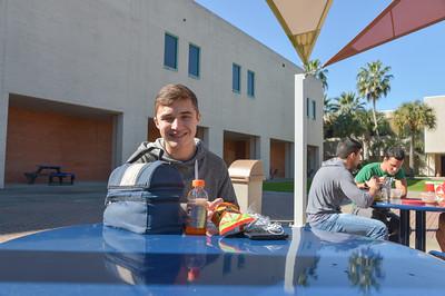 Caleb Mccann taking a break to enjoy his lunch.