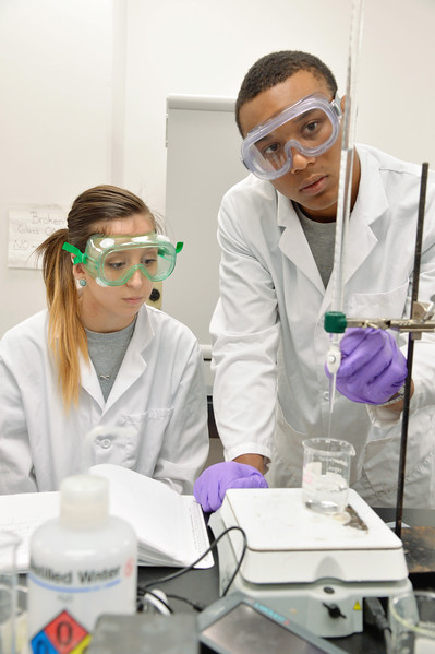 Lilian Arroyo (left) and Kai Paul work on chemical analysis of a titration.