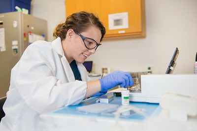 Student Josette Delgado during a demonstration of the microbalance, located in the Isotope Core Laboratory in TAMU-CC.