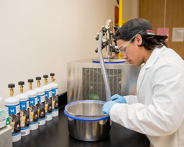 Student Branden Canete prepares biological samples using a freeze dryer in TAMU-CC's Isotope Core Laboratory.