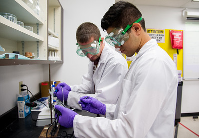 Joshua Mettlach (left) and Michael Rodriguez set up the lab equipment to determine the absolute zero of the particles in General Chemistry I.