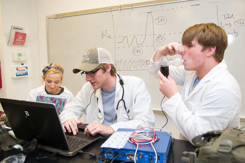 Student John Henersen(right), Zach Russell and Lauren Lanier co-operate on recording maximum voluntary ventilation in physiology lab.