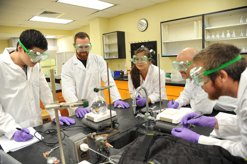 """Students Mario Mardinez(left) Carl Suding, Leticia Cardenas, Chad Sims and Jordan Layton observe during the lab titled """"Chemical Equilibrium"""" Tuesday July 28, 2015."""