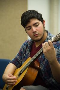 Eli Gonzalez practice right hand technique in Guitar I.