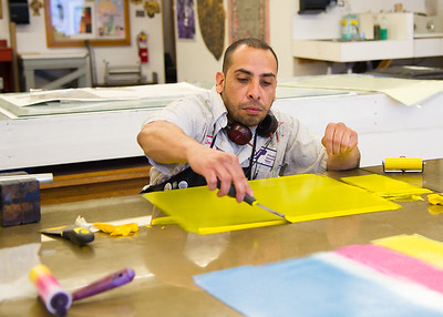 Graduate student Javier Flores prepares ink to be used in his print during the Masters in Fine Arts Printmaking course.