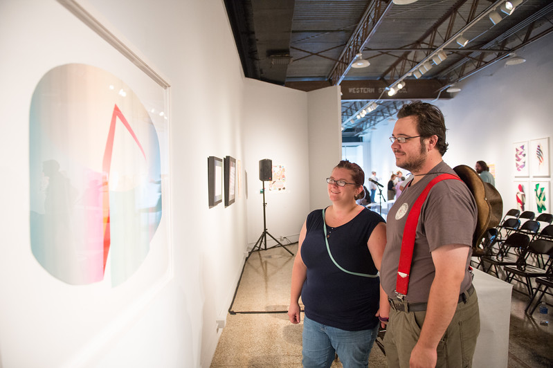Erika McIinay and Al Johnson during the I Have to Magic Yet opening reception in the Islander Gallery, Saturday September 12, 2015.