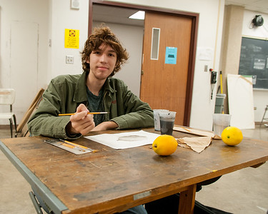 Alex Talmon drawing a lemon for his Drawing II class in the Center for the Arts.