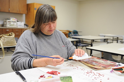 Delea Sanborn working on her landscape collage in her Design I course.