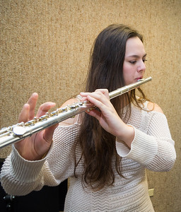 Music major, Amy Rubio, practices scales on her flute before her next class.