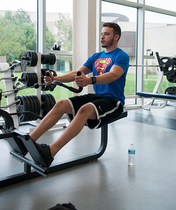 Miguel Muñoz Jr. takes a break to go workout in the Dugan Wellness Center.