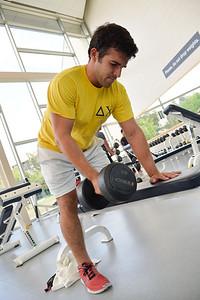 Student Daniel Valdenegro does his shoulder stranning