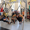 students-and-staff-get-a-workout-during-a-trx-training-session_15342274105_o