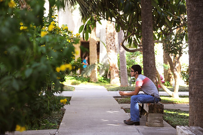 Student Aron Castro takes a break in the court yard before his History test.