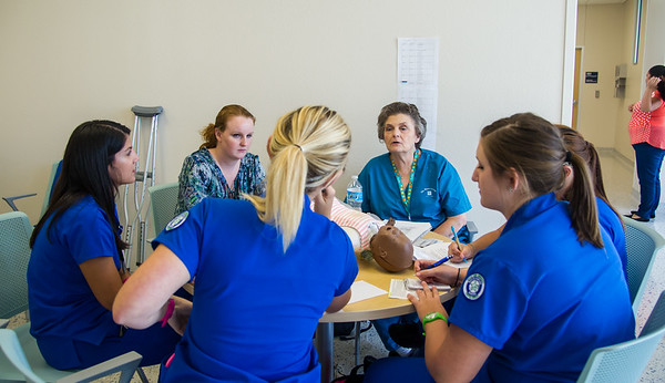 A group of nursing students prepare for their OB Simulations by listening to volunteers speak.
