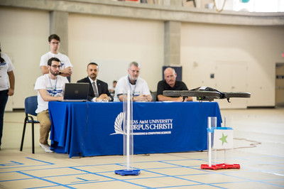 Judges watch as the UAS takes part in the final obstacle challenge part of the UAS Summer Institute.
