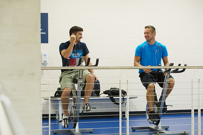 Tye Eldridge and Justin Webb share their thoughts while warming up in the Dugan Wellness Center.