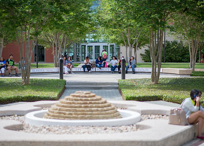 Students relax at Lee Plaza between classes.