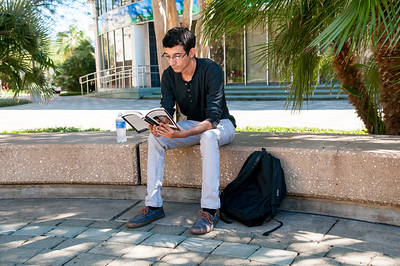Kenneth Flint, sophomore, catches up on some reading in Lee Plaza during our cool weather.