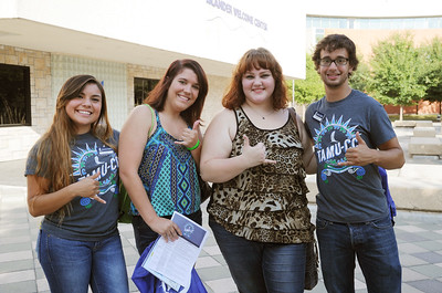 Island Ambassadors Bridget Deleon(left) , Zackary A.(right) and new student Sarah Hawkins, Miriam D. show their Islander pride during the first day of orientation.