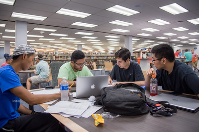 Students Oliver Belleza, Kyle Jacobs, Ellis Manoz, and Vincent Mai get together in the Mary and Jeff Bell Library to study for their calculus final
