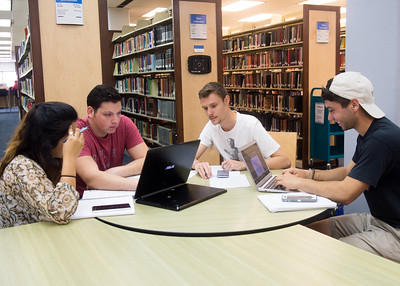 Students Jackie Roman (left), Zac Lewis, Vinnie Von Poyveld, and Justin Dear study for a Marketing exam.