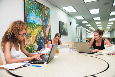 Students' Kianna Martinez (Left), Briana Gavito (Middle), and Morgan Yendrey (Right) all study together for there various online summer II courses