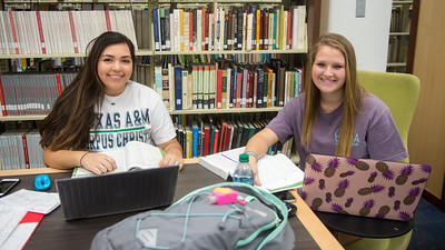 Students Annie Hernandez and Allison Abbott study side by side for their nursing exam.