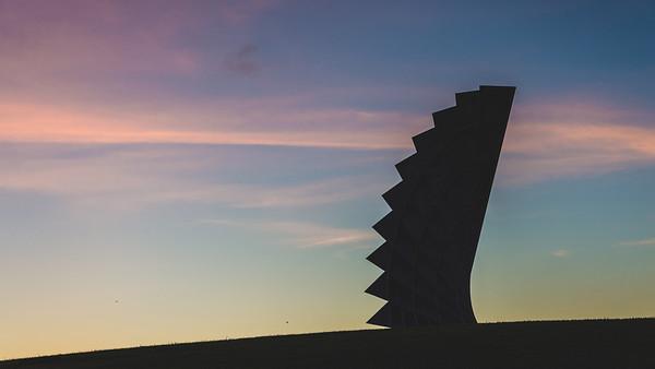 Momentum sculpture at sunset.