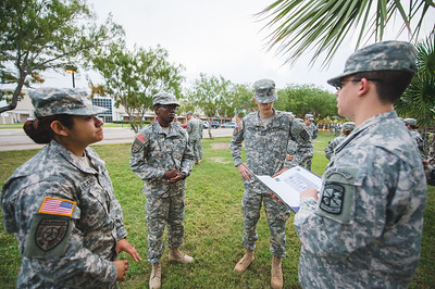 Maria Arellano(left) Arden Scott, Caleb Briehn and Kristopher Marrou get breifed on chain of command.