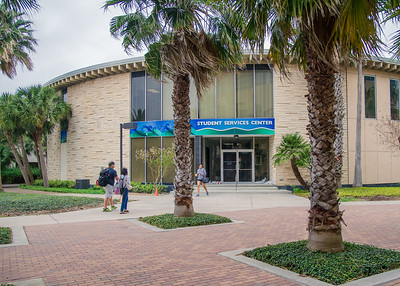 Students walk to and from the Student Services Center.