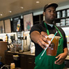 Starbucks cafe worker Jamar Dalton prepares one of many delicious drinks for customers.
