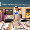 Varsha Patel(left) and Javier Reyes browse through posters for sale in the University Center's Legacy room, Wednesday September 23, 2015.