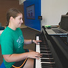 Lauren Mehring takes time away from studying to play the piano in the University Center.