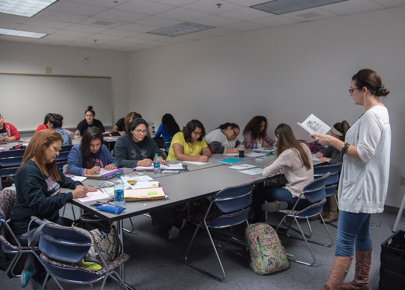 Students prepare illustrations as Visiting Professor Rosalynn Chistensen reads out loud during her Principles and Practices of Early Reading Instruction course.