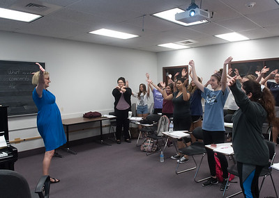 Professor Jana Sanders leads her class in exercises during her Child Development class.