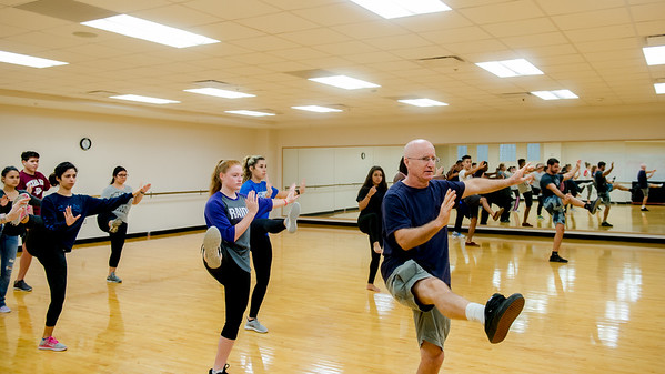 Students practice Tai Chi in Tai Chi class of Professor Paul Bystedt