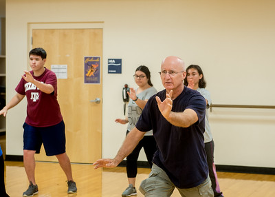 Students practice Tai Chi in Tai Chi class of Professor Paul Bystedt.
