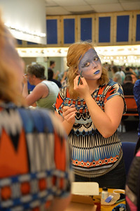 Student Cynthia Perry doesmake up practicing in Stage make up class.