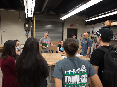 Jack Gronn speaks to his students during his sculpting class.