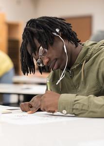 Student Neiman Ward creates different designs using Micron pens in Design I.