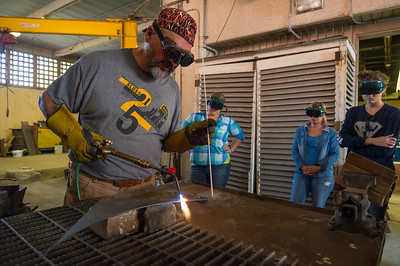 Sculpting instructor Jack Gron demonstrates proper brazing techniques to his Intermediate Sculpture students.