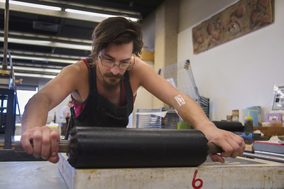 Student Andrew Mordoch, begins the process of creating a print in his MFA Printmaking course.