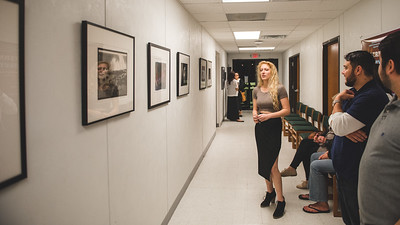 Allisan Montgomery speaks to attendees during her photography class's photo critique.