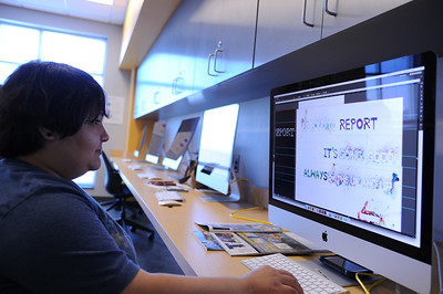 Lorena Hernandez touching up her Typography assignment in the Think Tank located in Bay Hall.