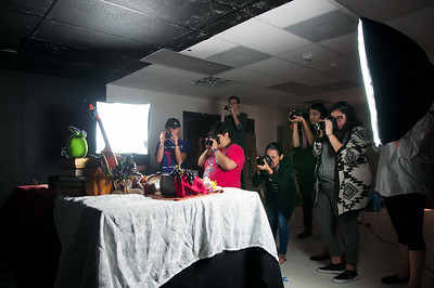 Photo I - Digital Photography students taking pictures of still objects for their still life project.