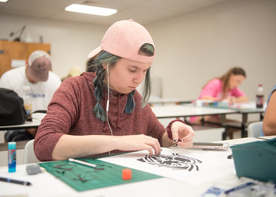 Islander student Allison Smith carefully pieces her Design I project together.