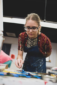 Kayla Massey mixes her primary blue with white to get a lighter blue to apply to her Impasto Portrait for intermediate Painting.
